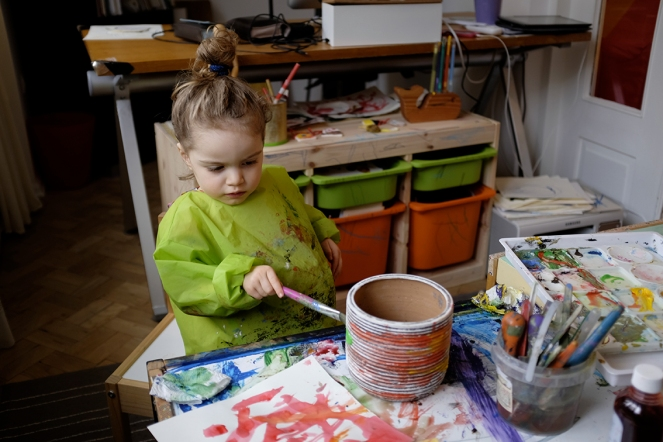 Child Decorating a Flower Pot